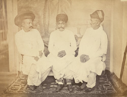 Studio portrait of three Shenoy Bhatias, Bombay.